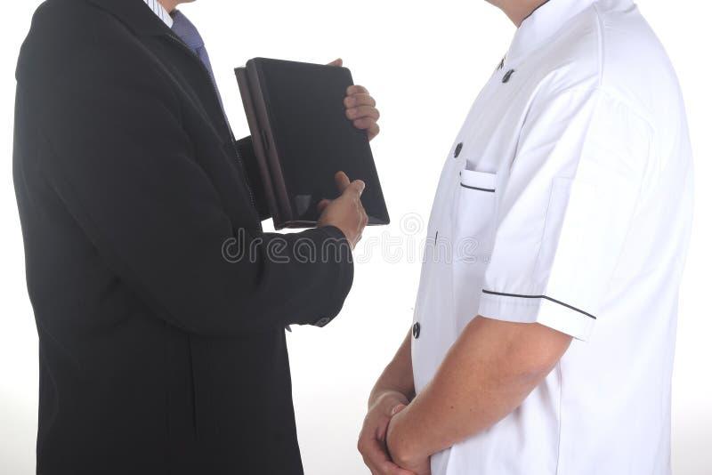Kierownika spotkanie z szefem kuchni zdjęcie royalty free