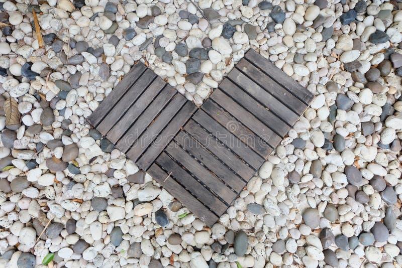 Kierowy kształtny drewno z kamiennym tłem zdjęcia royalty free
