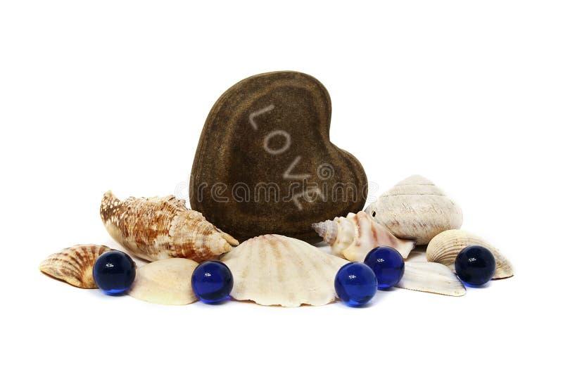 Kierowych miłość seashells błękitni kamienie zdjęcie royalty free