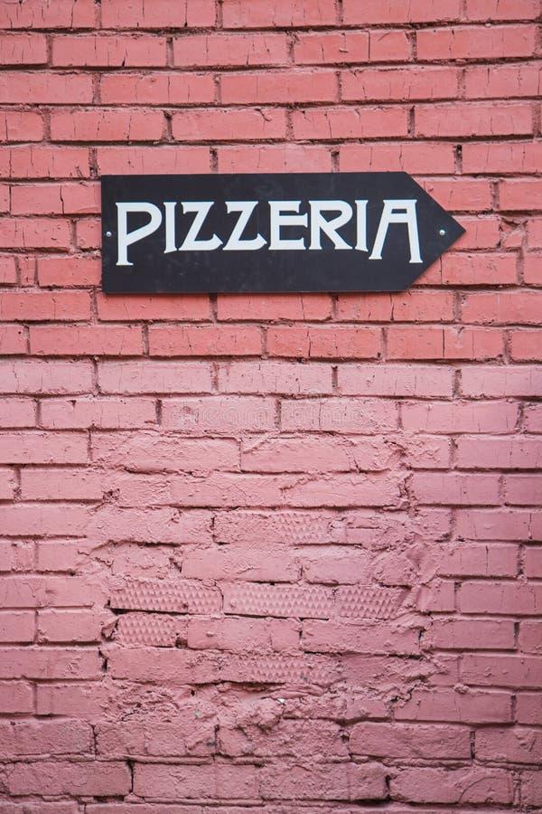 Kierunkowskaz pizzeria fotografia royalty free