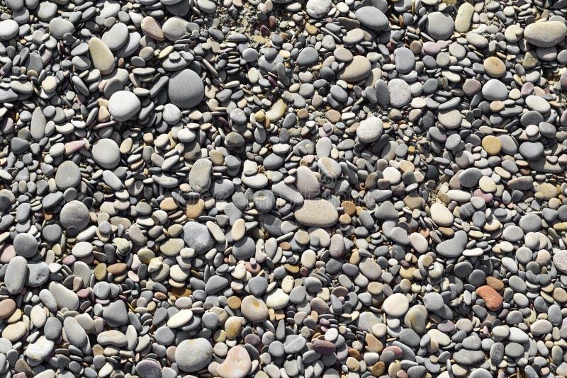 Kiesel eines Schindelstrandes oder des Flusses lizenzfreies stockbild