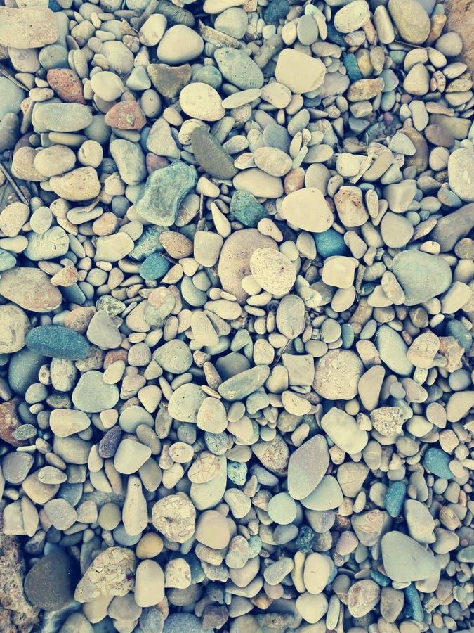 Kiesel am Strand lizenzfreie stockbilder