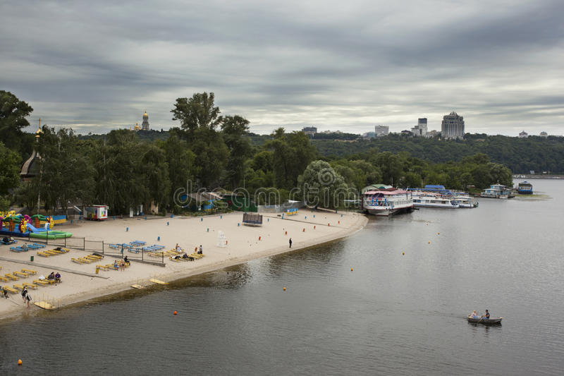 Kiev beach, Dnepr and boats on river, Ukraine. Kiev beach, Dnepr and boats on river. Before the thunderstorm stock images