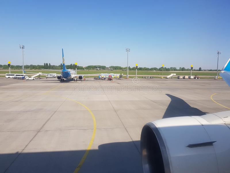 Kiev, Borispol, Ukraine - May 02, 2018: view from the window of an airplane at the airport. Preparing for takeoff royalty free stock image