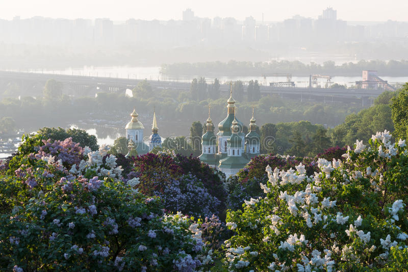 Kiev is the capital of Ukraine. Spring landscape. City of Kiev - capital of Ukraine. Botanical Garden with blossoming lilac bushes. View of the Vydubychi royalty free stock images