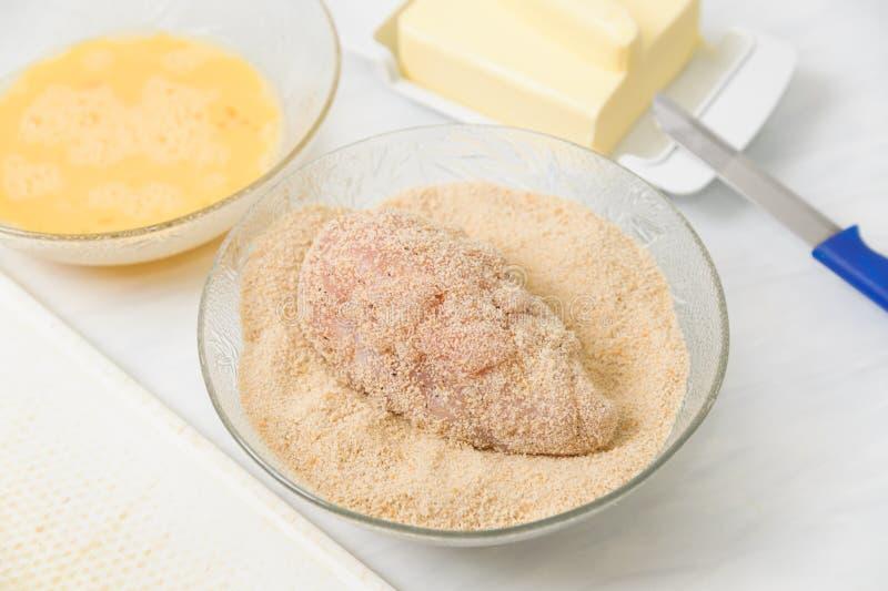 Kiev cutlets. Cook chicken Kiev cutlets in studio stock photography
