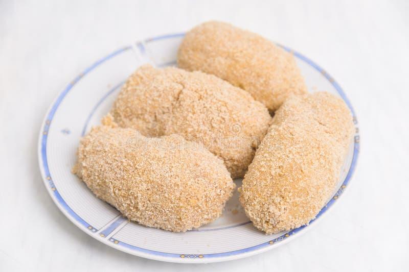 Kiev cutlets. Cook chicken Kiev cutlets in studio royalty free stock photos