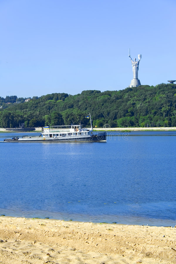 Kiev Dnepr homeland-mother. Monument and cutter on river stock photo