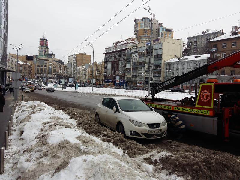 Kiev, March 6, 2018, Ukraine. Traffic police officers on street to pick up intruder`s car on tow truck. Loading tow truck car of stock photo