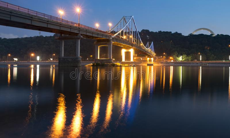 Kiev Pyshododnyj Mint through the leap of the Dnieper, a colorful glow of the night of a European city stock image