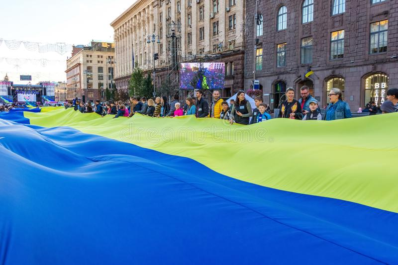 Kiev. September 2018. Big ukrainian flag stretched out on Khreschatyk Street during the Thanksgiving holiday_ stock photos