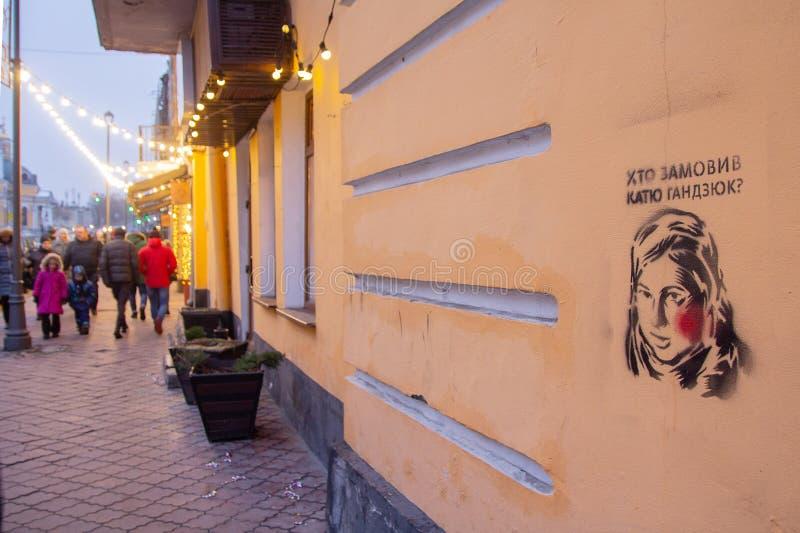 Kiev, Ucrania - 30 de diciembre de 2018: Pintada en la pared de la calle de Kiev con un retrato de un activista asesinado fotografía de archivo libre de regalías