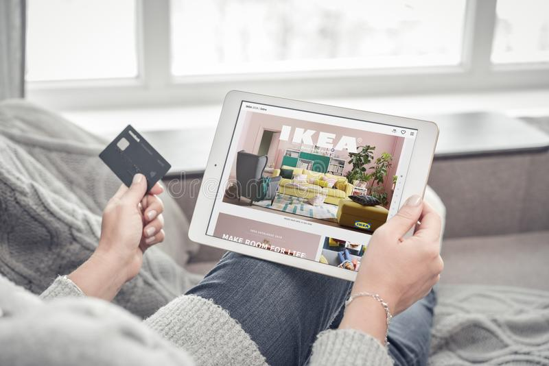 Woman using IKEA app on a brand new Apple iPad Pro Silver to order furniture. Kiev, Ukrain - February 10, 2018: Woman using IKEA app on a brand new Apple iPad royalty free stock photography