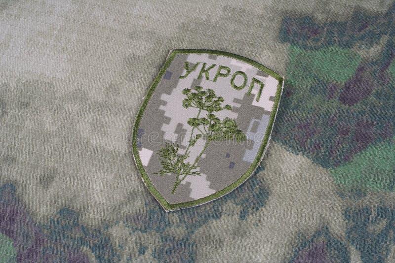 KIEV UKRAINA - April 26 2015 Inofficiellt enhetligt emblem för Ukraina armé royaltyfria foton