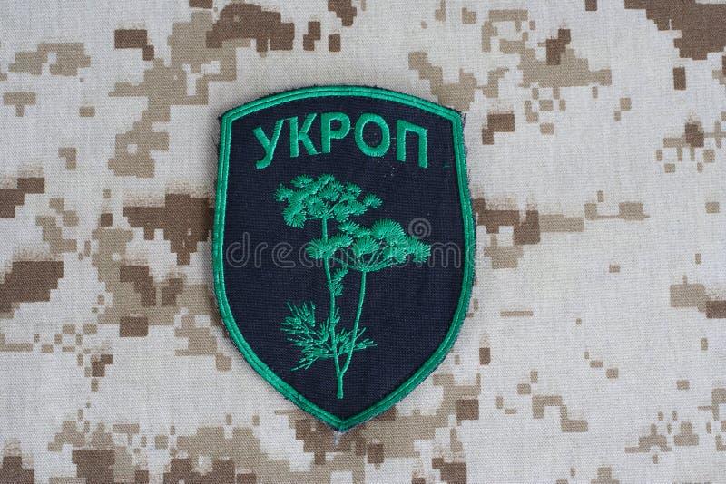 KIEV UKRAINA - Juli, 08, 2015 Inofficiellt enhetligt emblem för Ukraina armé royaltyfri fotografi