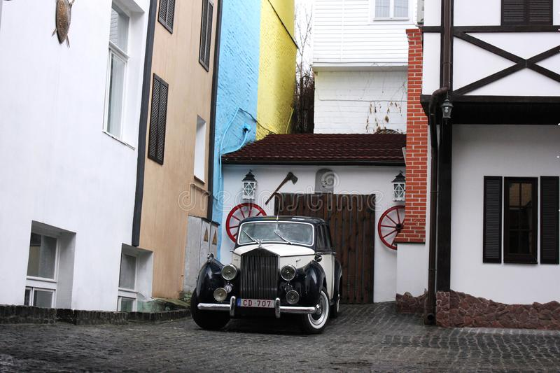 Kiev, Ukraine; April 10, 2014. Old cars on the background of the old buildings in the English style stock photo