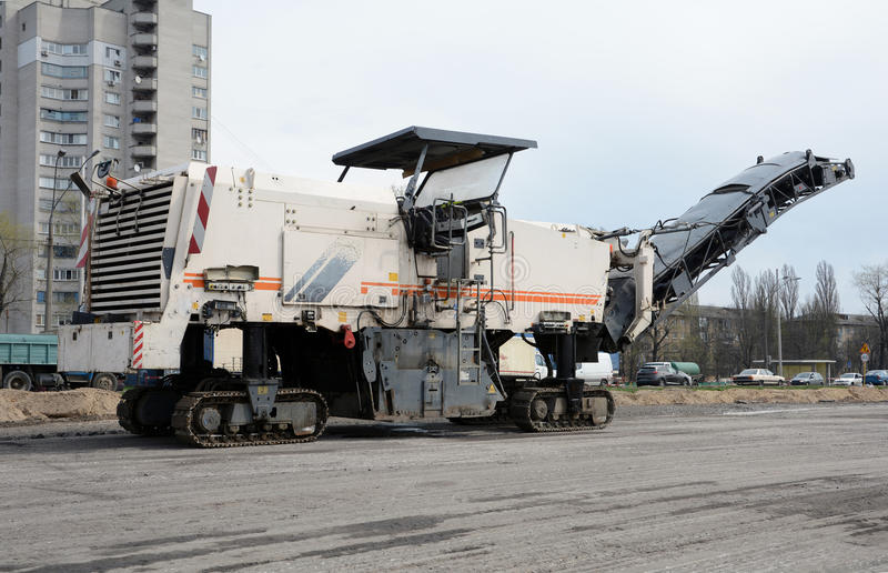 KIEV, UKRAINE - APRIL 6, 2017: Shredded removed the old asphalt road milling machine. Road construction work. KIEV, UKRAINE - APRIL 6, 2017: Shredded removed stock image