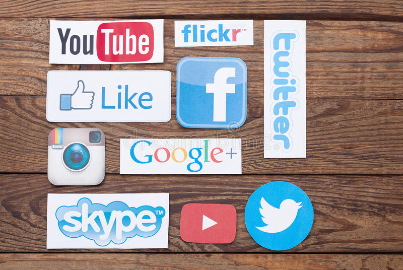KIEV, UKRAINE - AUGUST 22, 2015:Collection of popular social media logos printed on paper:Facebook, Twitter, Google Plus royalty free stock photography