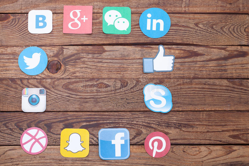 KIEV, UKRAINE - AUGUST 22, 2015:Collection of popular social media logos printed on paper:Facebook, Twitter, Google Plus royalty free stock photos
