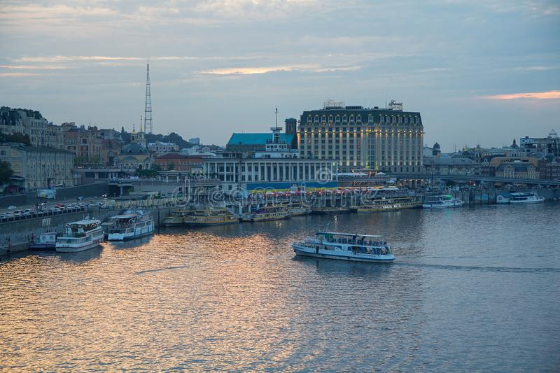 Kiev, Ukraine - August 06, 2018: View of the right side of the Dnieper, buildings and river port, pleasure boat stock image