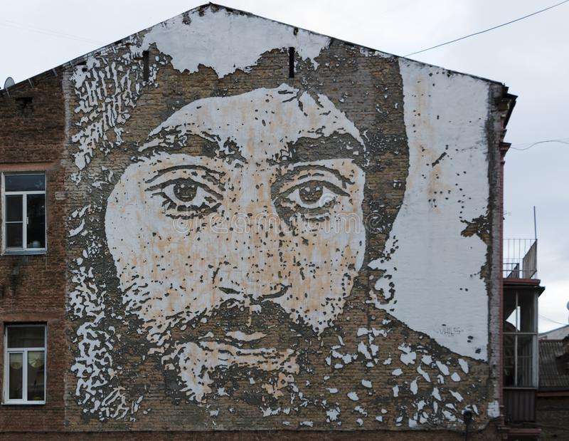 KIEV, UKRAINE - desember 19, 2017: Photo of the hero of EuroMaidan Sergey Nigoyan engraved on the wall of the house in royalty free stock images