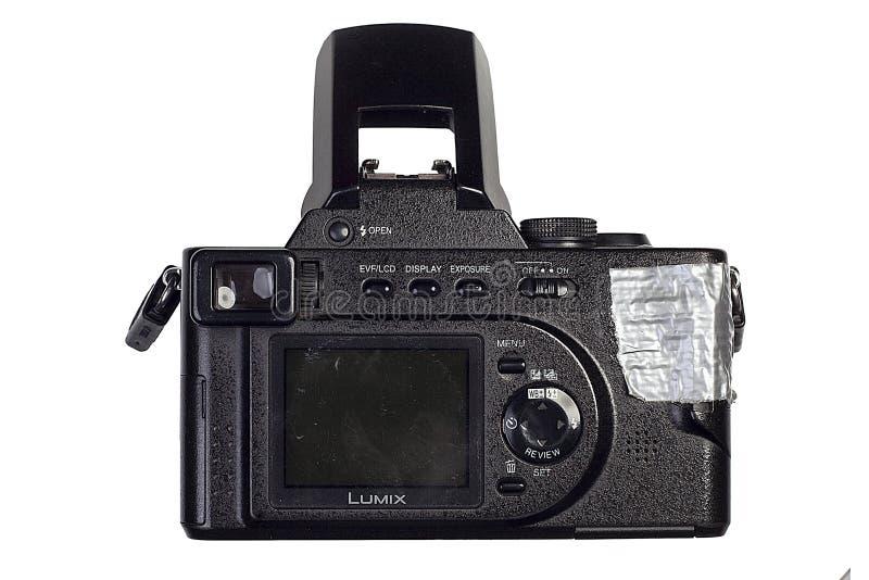 Kiev, Ukraine - February 04.2017: Photo Panasonic Lumix DMC-FZ10 mirrorless camera with digital display behind. On a white background royalty free stock photos