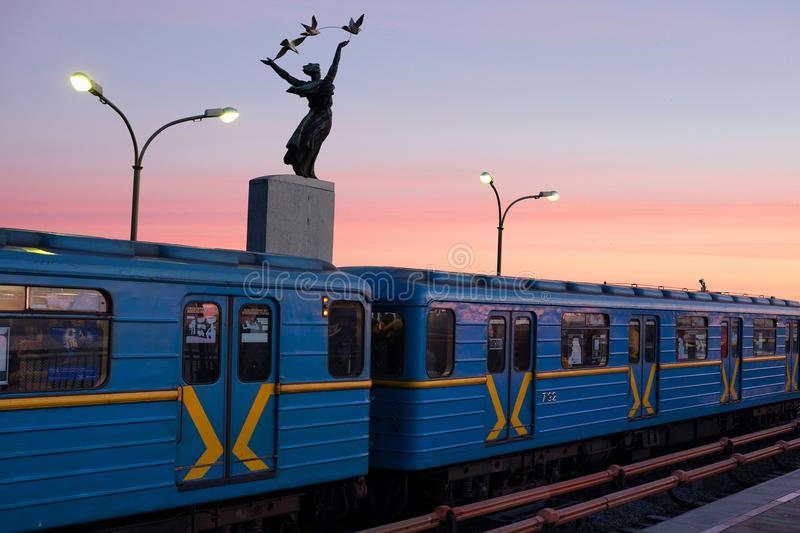 KIEV, UKRAINE - JANUARY 10, 2018: Kiev metro station Dnipro. Subway train against sky. People going to work in the subway stock image