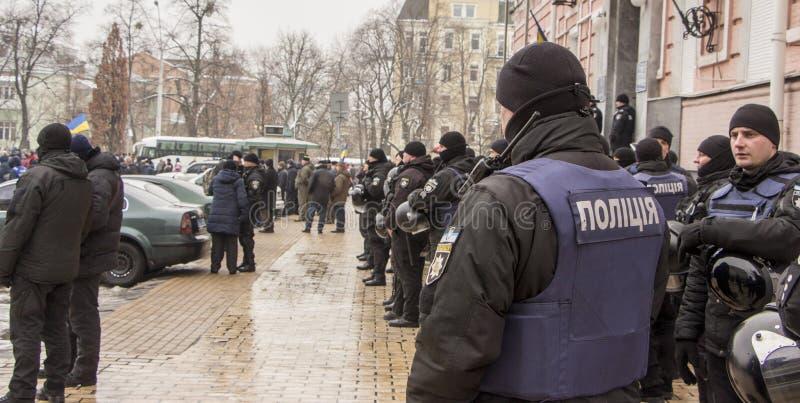 Kiev, Ukraine - January 18th: Ukrainian policemen in black uniforms on Mikhailovskaya Square are guarding the order stock photo