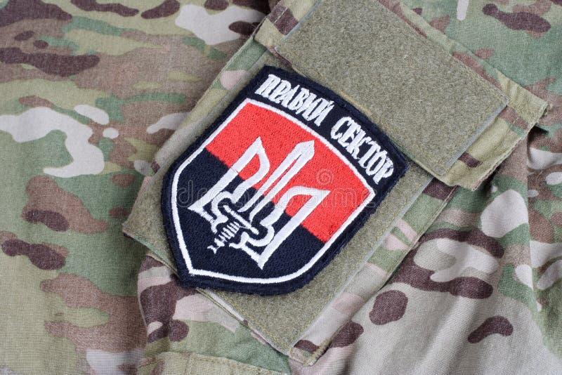 KIEV, UKRAINE - July, 08, 2015. Chevron of Ukrainian volunteers corps with the words. `Ukrainian Volunteer Corps Right Sector royalty free stock photography