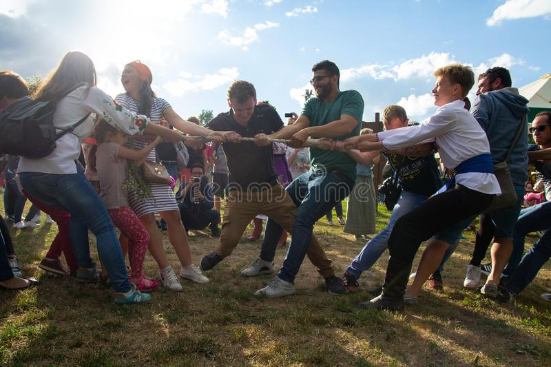 Kiev, Ukraine - July 06, 2017: Men and girls compete in tug of war on the traditional holiday of Ivan Kupala royalty free stock photos