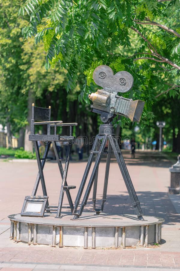 Kiev, Ukraine - July 20, 2019: Monument of Movie Camera and Cameraman Cinema Director Chair royalty free stock photography