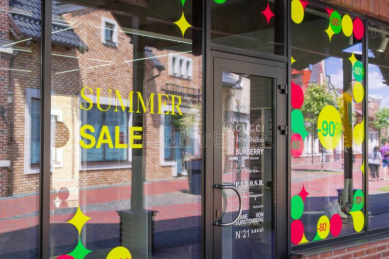 Kiev, Ukraine - July 6, 2019: Signage of Summer Sale in the Shop Window in Outlet Village called Manufaktura Shoping Center Looks royalty free stock photo