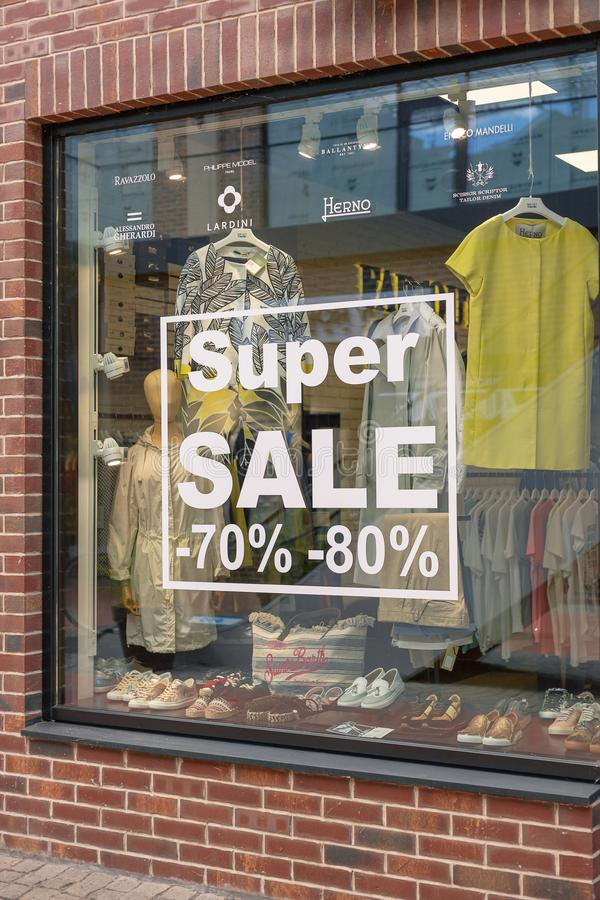 Kiev, Ukraine - July 6, 2019: Signage of Super Sale in the Shop Window in Outlet Village called Manufaktura Shoping Center Looks stock photography
