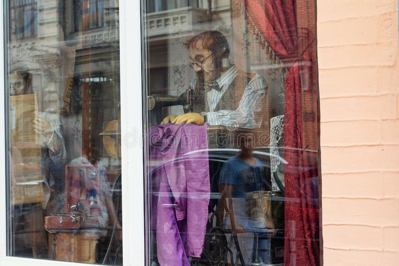 Kiev, Ukraine - July 02, 2017: Tailor`s mannequin with a sewing machine in the window royalty free stock photos
