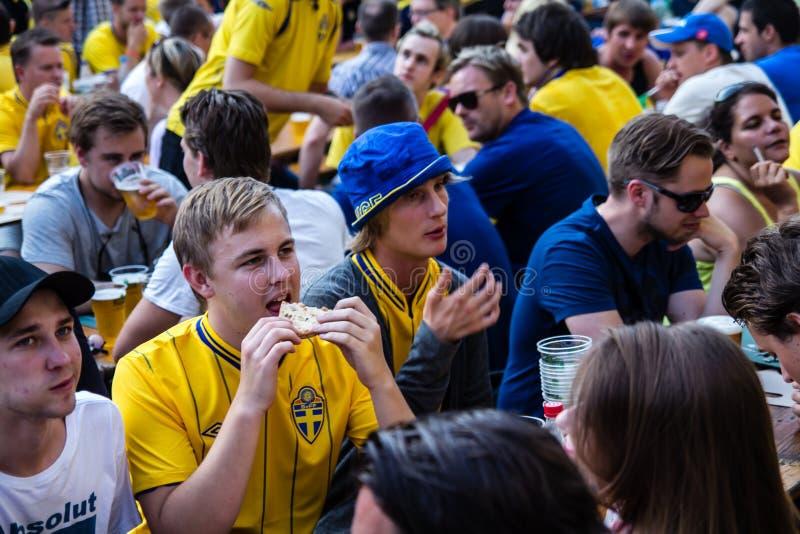 KIEV, UKRAINE - JUNE 10: Cheering Sweden and Ukrainian fans have