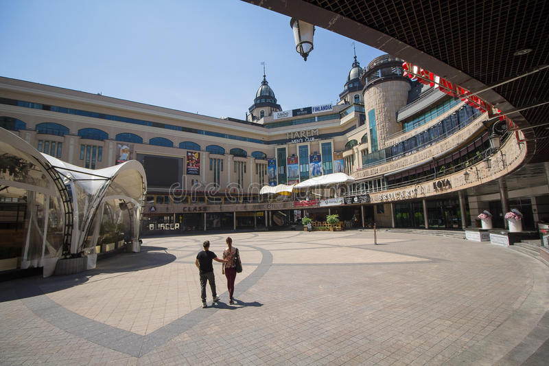 Kiev, Ukraine - June 18, 2017: Couple is at noon in an empty entertainment. And shopping center royalty free stock photos