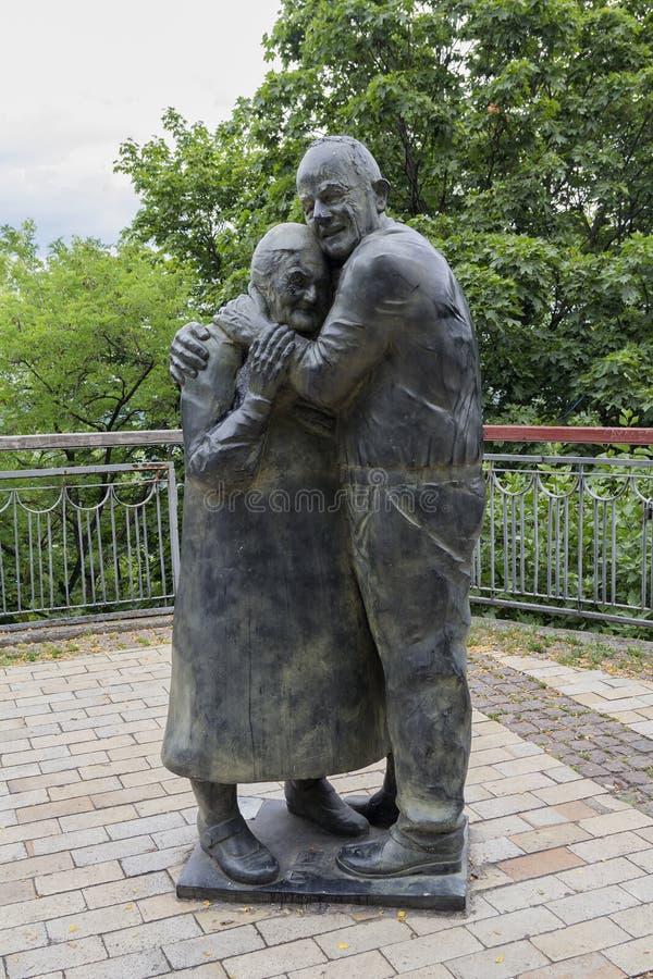 Kiev, Ukraine - June 24, 2017: Monument to Italian prisoner of war Luigi Pedutto and consigned to forced labor Ukrainian Mokrin Yu. Rzuk. Meeting after 60 years stock image