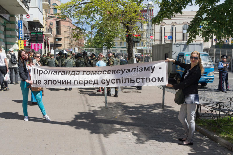Kiev, Ukraine - June 12, 2016: Opponents of the parade of sexual minority with a poste. R - `Propaganda of homosexuality - a crime against society` in the royalty free stock image