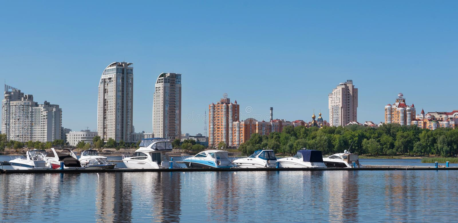 Kiev, Ukraine - June 01, 2018 : Sailing yachts and private boats on a pier in the river. yachts in the gulf in river port in the stock photography