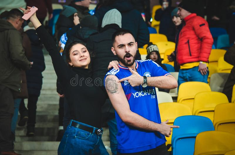 Kiev, UKRAINE - March 14, 2019: Chelsea  fans support the team during the UEFA Europa League match between Dynamo Kiev vs Chelsea. (London, England), NSC royalty free stock images