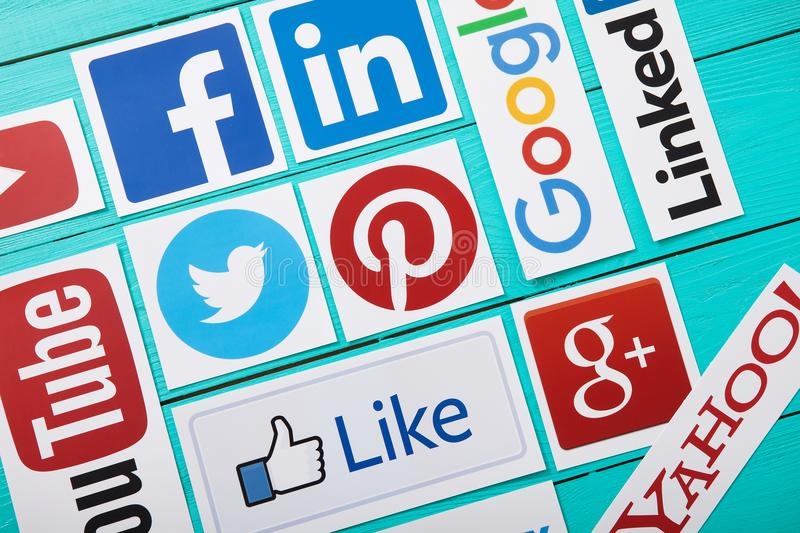 KIEV, UKRAINE - MARCH 10, 2017. Collection of popular social media logos printed on paper: YouTube,Facebook, Twitter, Google Plus. stock photo