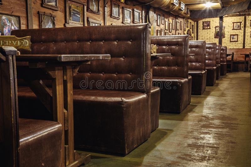 Leather sofas at the tables are in a beer pub or in a nightclub. Kiev, Ukraine- March 19, 2018. leather sofas at the tables are in a beer pub or in a nightclub stock images