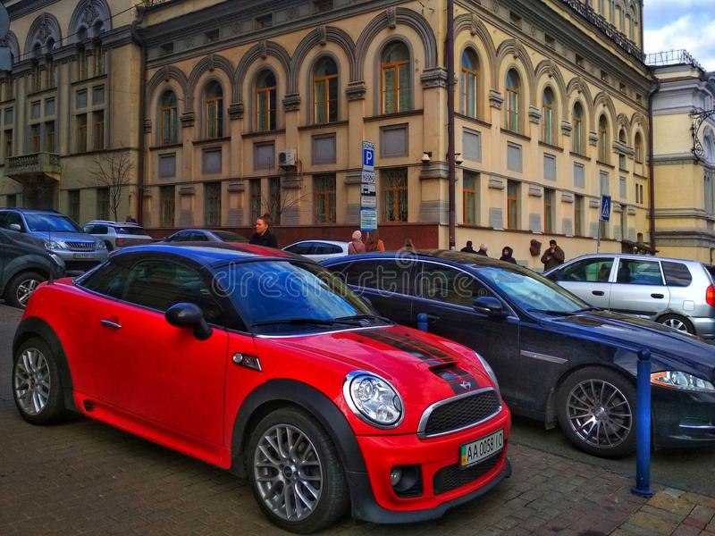 KIEV, UKRAINE - MARCH 26, 2019: Red car Mini Cooper on the background of the city. stock photography