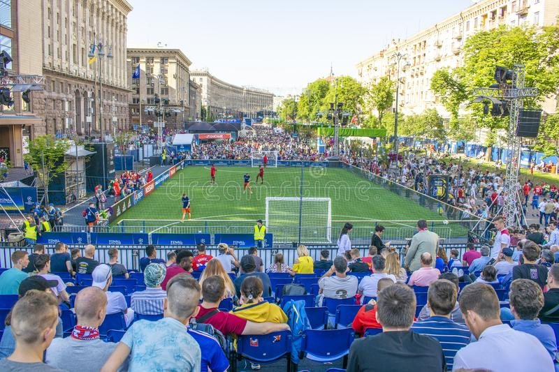 KIEV, UKRAINE - MAY 26, 2018: Fan-zone of the football fans of the final of the UEFA Champions League. People and football fans wa. Lking around the street fan royalty free stock photo
