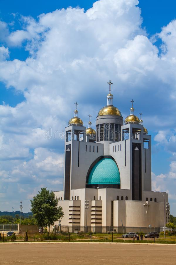 Kiev, Ukraine - May 26, 2019: the five-domed modern church and the square landscaped with fir trees royalty free stock image