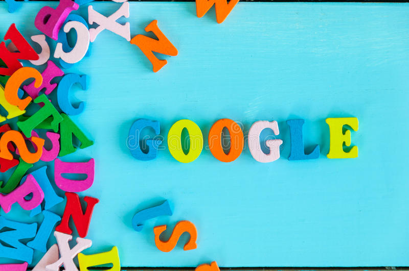 KIEV, UKRAINE - MAY 09, 2017: Google - word composed of small colored letters on blue background. Google is USA royalty free stock images