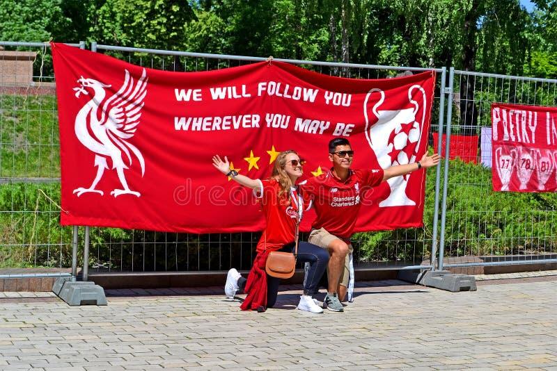 Happy Liverpool fans in red uniform, big banner before UEFA Champions League Final 2018, Kiev, Ukraine,. KIEV, UKRAINE - MAY 26: Happy Liverpool fans in red stock photos