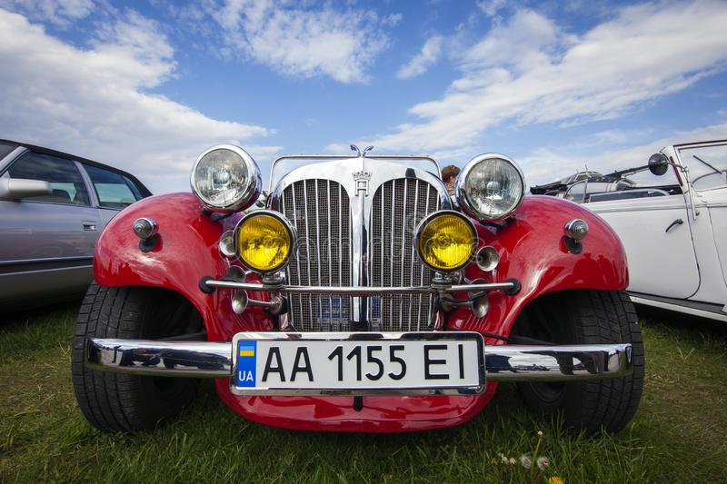 KIEV, UKRAINE - MAY 10, 2019: Luxury red retro car with a chrome grille against a blue sk. Y. Retro car festival royalty free stock image