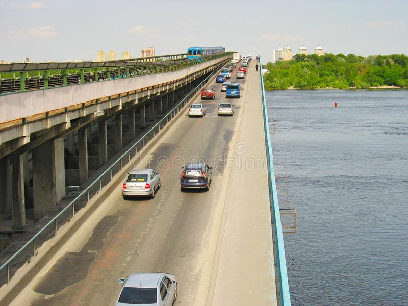 Traffic on the metro bridge across wide river royalty free stock photography