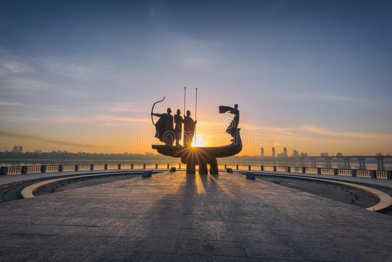 Kiev, Ukraine - May 05, 2018: Monument to the founders of Kyiv Kiev at sunrise, beautiful cityscape in fiery sunlight stock photos